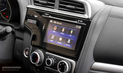 small resolution of the climate and audio controls are easy to reach and understand and while the touch sensitive surface of the former are hard to pinpoint on bumpy roads