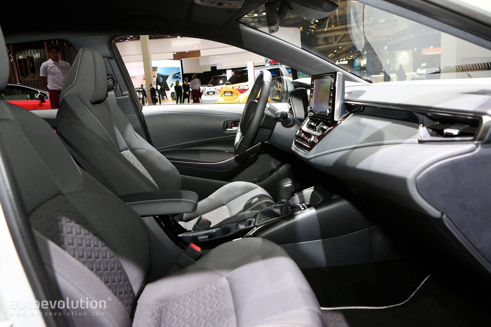 hight resolution of  toyota corolla hybrid wagon has giant trunk and even bigger tablet in paris