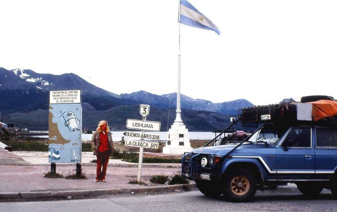 Liliana Schmid and a their Toyota Land Cruiser FJ60 in Ushuaia