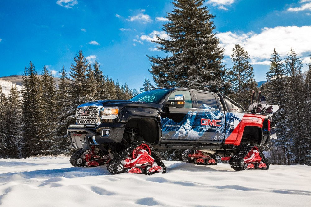 medium resolution of 2018 gmc sierra hd takes on snow covered mountains with rubber tracks