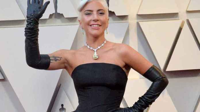 Lady Gaga made history by posing with the yellow diamond, the world's largest Tiffany & Co.