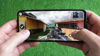 Playing Call of Duty on the Xiaomi Redmi Note 10S.