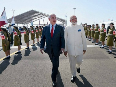 Benjamin Netanyahu and Narendra Modi at Tel Aviv airport on Tuesday. PTI