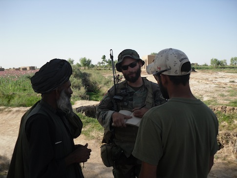 Special Forces Captain Matt Golsteyn, center, talks to Afghan villager, April 2010 / Author photo