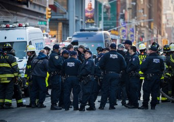 New York City Police Department officers and other first responders work the scene after an attempted terror attack in a passageway linking the Port Authority Bus Terminal with the subway
