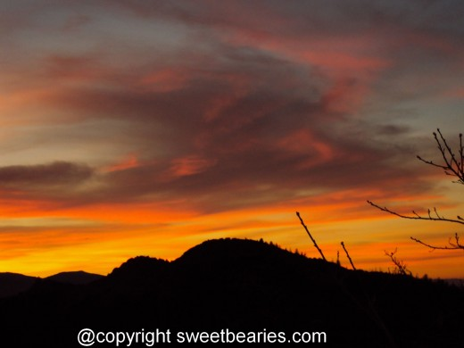The tangerine infused sunset with the silhouette of the San Bernardino Mountains.