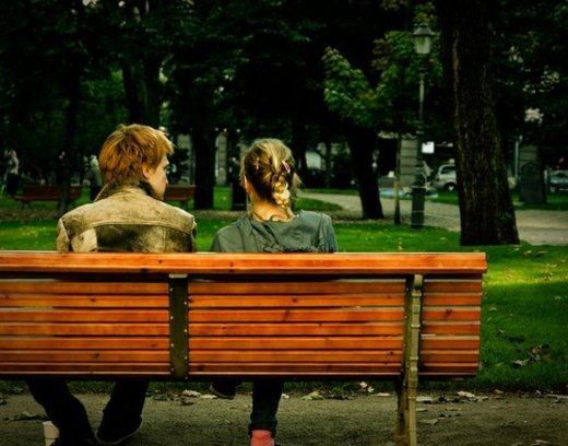Young man and woman on the bench.