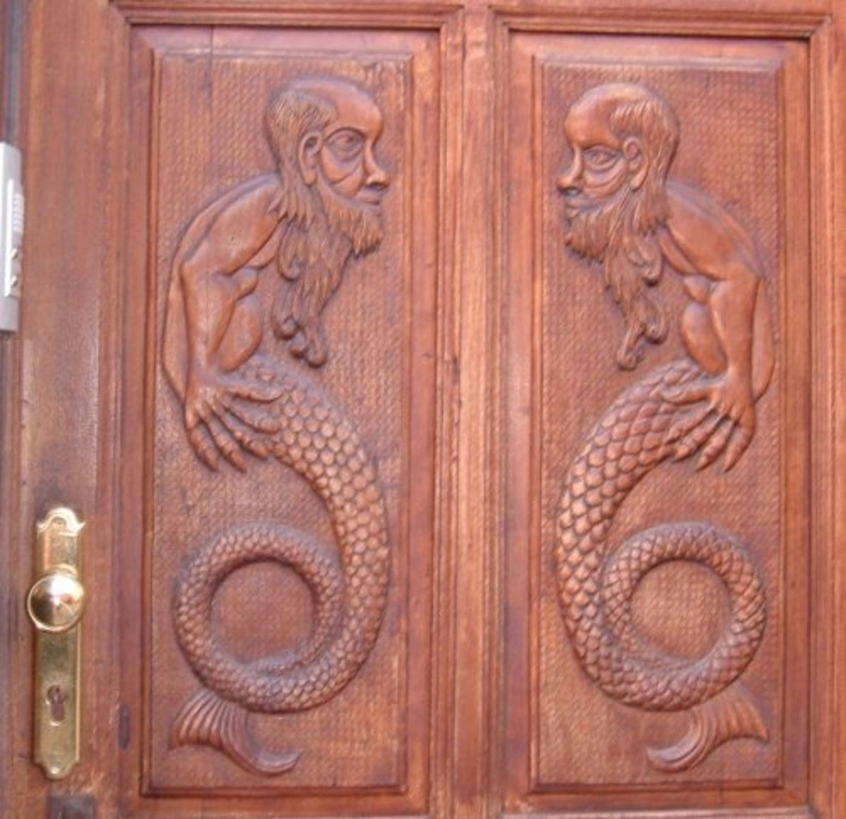 Mermen on a door in Icod town centre