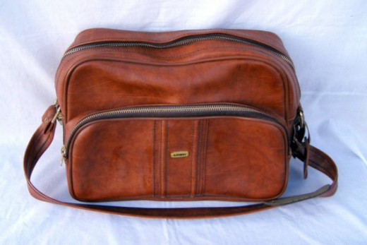 or small loking duffle bags or something that has the shape of one of your toiletry bags