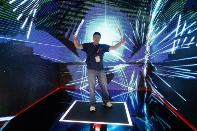 "A man plays ""Beat Saber"" during the E3 Video Game Convention in Los Angeles in June 2019"