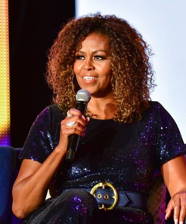 michelle obama rocks curly hair at essence festival