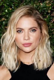 blonde hair dark eyebrow celebrity