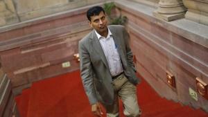India's chief economic adviser Raghuram Rajan walks inside the finance ministry in New Delhi August 6, 2013. REUTERS/Adnan Abidi