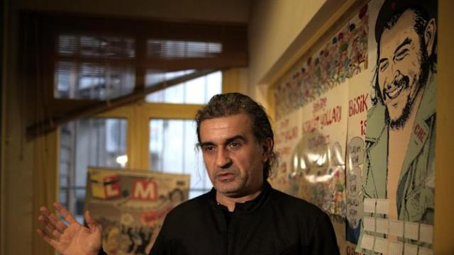 Zafer Aknar, editor of Turkey's satirical weekly Leman, speaks to The Associated Press in Istanbul, Turkey, Friday, Jan. 9, 2015. Aknar and his team are preparing a special tribute edition to their colleagues at Charlie Hebdo, with whom Leman had published two joint issues in 2002. On Wednesday, masked gunmen stormed the Paris offices of Charlie Hebdo that caricatured the Prophet Muhammad, killing at least 12 people. (AP Photo/Emrah Gurel)