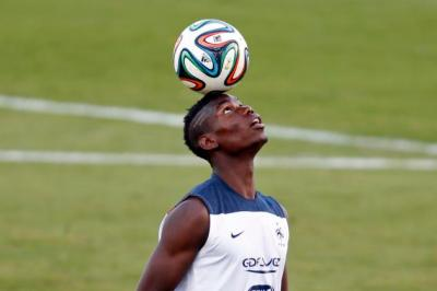 File photo of France's national soccer team player Paul Pogba controlling the ball during a training session in Ribeirao Preto