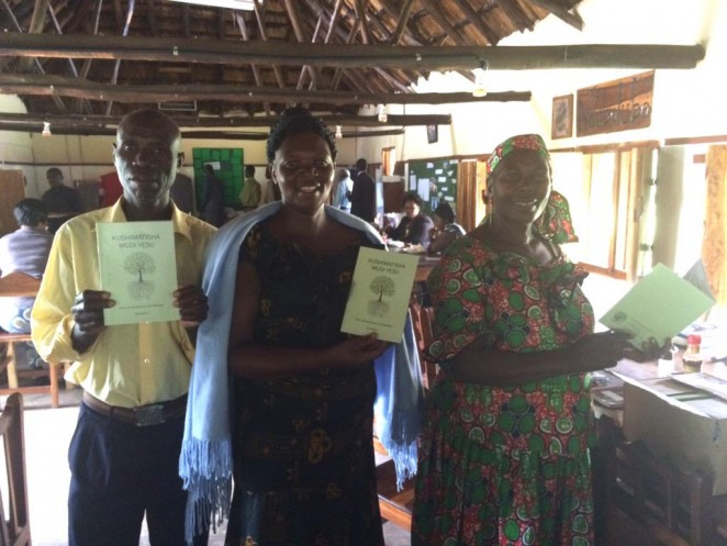 The Mwinilunga Impact Team receive Rooted in Jesus in Lunda