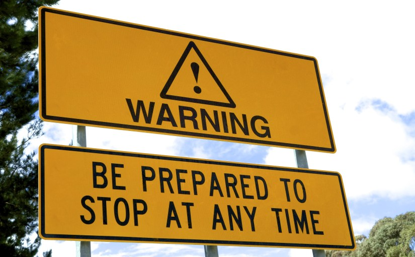 """""""Warning: Be Prepared to Stop at Anytime"""" by Michael Leslie; http://www.shutterstock.com/pic-271269641.html"""
