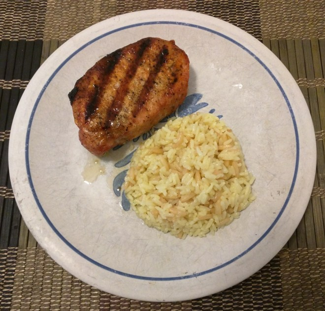 Grilled pork chops with rice pilaf