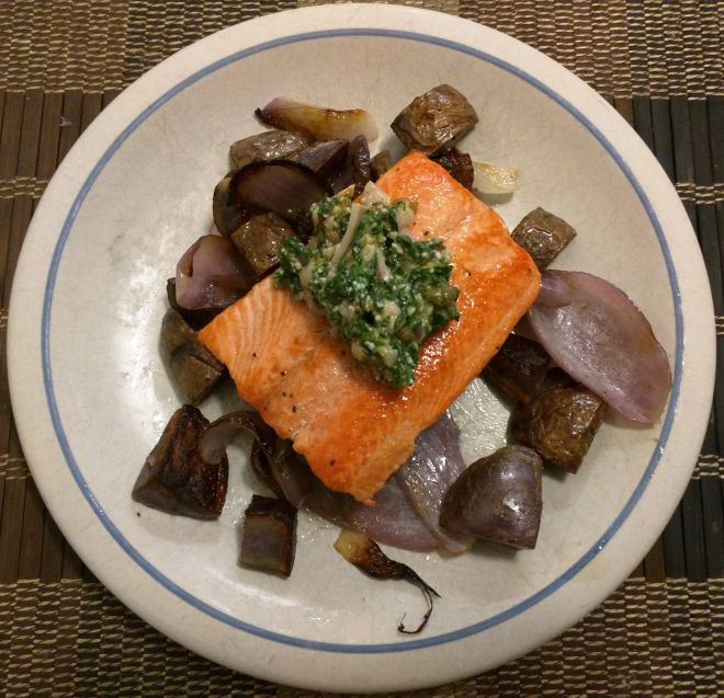 Salmon with spinach-walnut pesto and purple potato hash