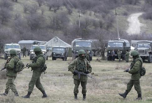 Russian soldiers guarding a Ukrainian infantry base / AP