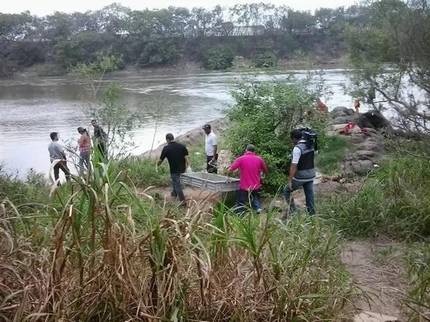 Dois homens morreram afogados no Rio Cuiabá, próximo a ponte Júlio Muller (Foto: André Barros/TVCA)