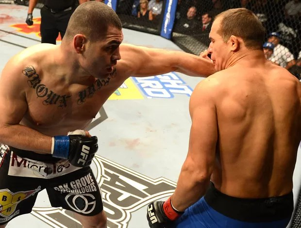 Cigano e Cain Velasquez, UFC 155 (Foto: Getty Images)