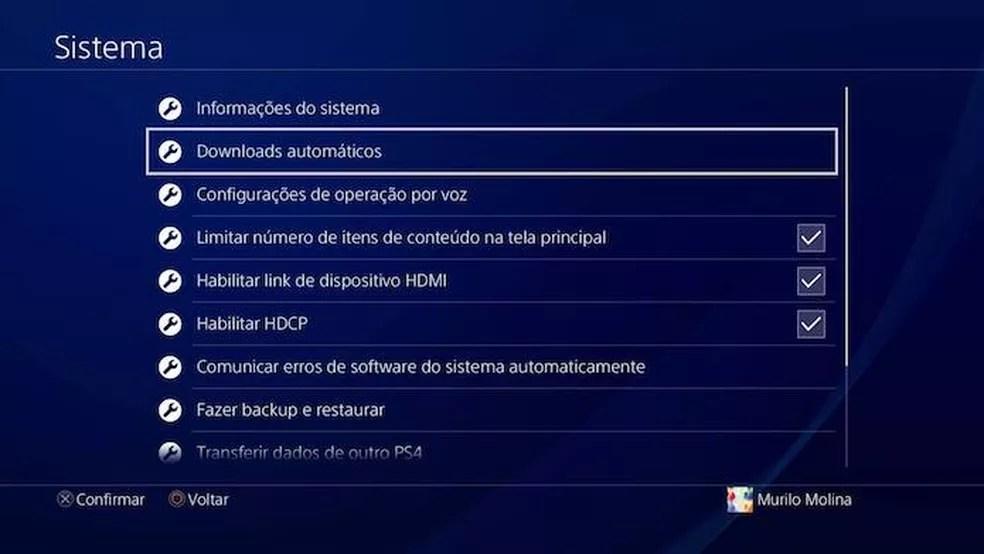Clique X em Downloads Automáticos no menu do PS4 (Foto: Reprodução/Murilo Molina)
