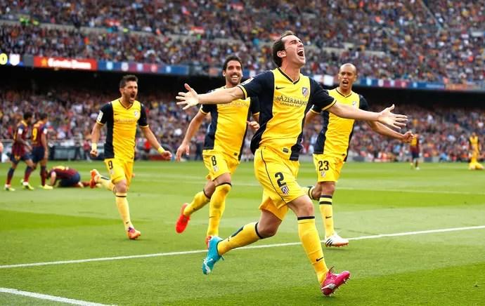 Godin comemora gol do Atlético de Madrid contra o Barcelona (Foto: Agência Reuters)