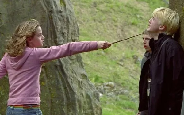 Tom Felton and Emma Watson in the harry potter franchise scene (Photo: Reproduction)