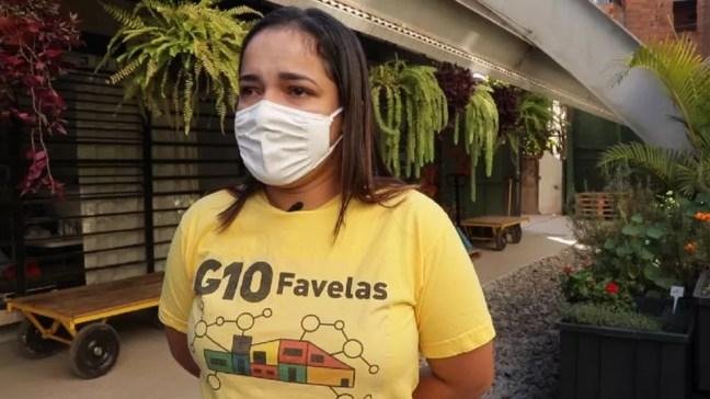 'Quando comecei, eu estava desempregada, estava desesperada', conta Graziele Jesus Santos, 25 anos, hoje empregada pelo G10 Favelas — Foto: CAIO CASTOR/BBC