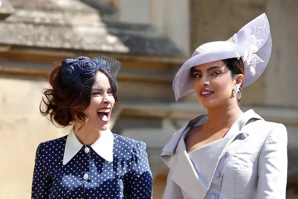 Actresses Abigail Spencer and Priyanka Chopra arriving at Winsor Castle for actress Meghan Markle's wedding to Prince Harry in May 2018 (Photo: Getty Images)