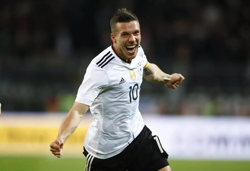 Podolski brilhou com a camisa alemã e conquistou o título mundial de 2014 (Foto: Reuters)