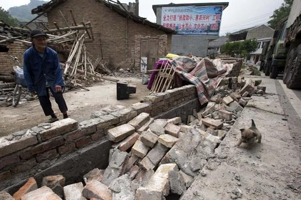 Terremoto deixou pelo menos 203 mortos e desaparecidos em Sichuan (Foto: Ng Han Guan/AP)