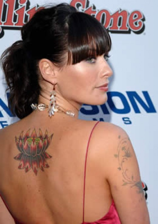 Britney spears tattoos tattoo pictures online for Justin timberlake tattoos removed