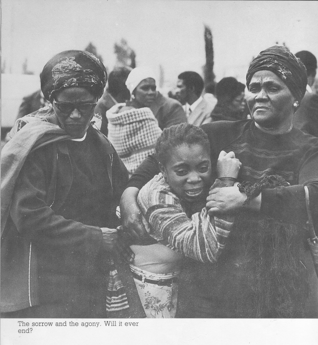 A woman crying from having lost a loved one. Africans spend most of their time, from the days of Apartheid murders and today's AIDS going to the cemetery to bury their dead, and crying most of the time.