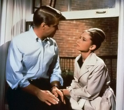 Audrey Hepburn in 'Breakfast at Tiffanys' wearing a Trench Coat