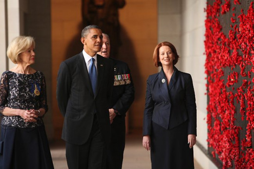 President Obama, Prime Minister Gillard and Governor General Quentin Bryce walk past the Wall of Remembrance