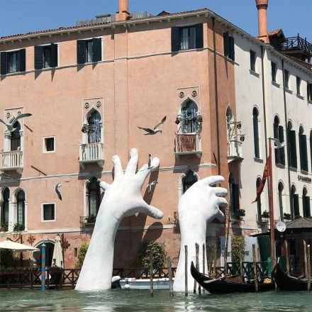 Monumental hands rise from the water in Venice to highlight climate change.