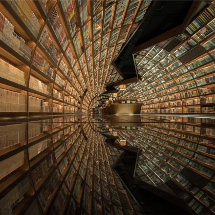 Tunnel of Books: Curved Shelves Wrap Bookstore Walls & Ceiling