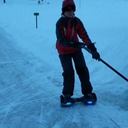 """Kid uses his """"hoverboard"""" to shovel snow"""