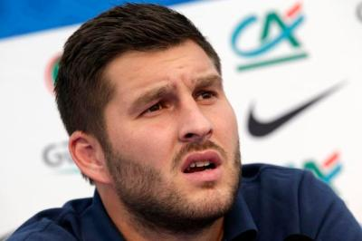 France's national soccer team player Gignac talks to journalists during news conference before a training session in Clairefontaine