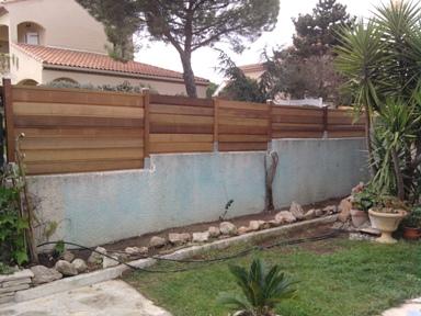 Surlvation de mur de clture  JEROME MULTISERVICES