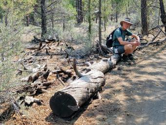 2-Spencer sitting on log