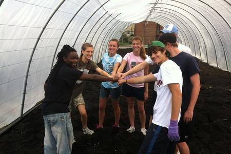 Volunteers in one of our hoop houses
