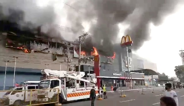 Smoke rises from burning mall's 3rd floor, in Davao City, Philippines, in this December 23, 2017 picture obtained from social media. Courtesy Otto van Dacula via Reuters