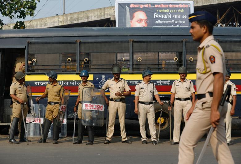 Policemen stand guard at a traffic junction in Mumbai, India, January 3, 2018. Credit: Reuters/Danish Siddiqui
