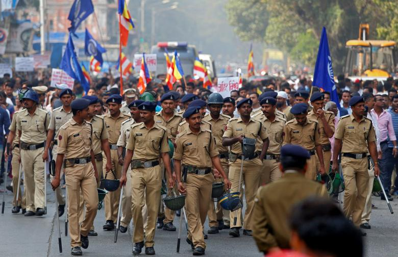 Police patrol a street as members of the Dalit community hold a protest in Mumbai, India, January 3, 2018. Credit: Reuters/Shailesh Andrade