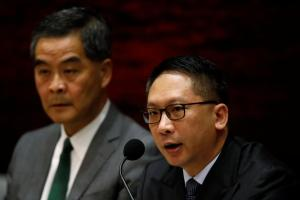 Hong Kong Chief Executive Leung Chun-ying (L) and Secretary for Justice Rimsky Yuen Kwok-keung speak during a news conference after China's parliament passed an interpretation of Hong Kong's Basic Law that says lawmakers must swear allegiance to the city as part of China, in Hong Kong November 7, 2016. REUTERS/Tyrone Siu