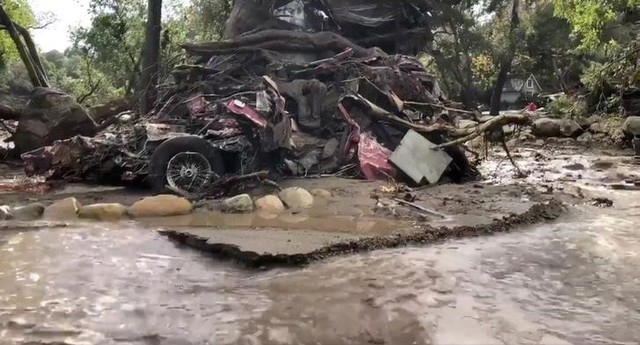 A vehicle is wrapped around a tree after flood and mudslides in Montecito, California, U.S. January 9, 2018 in this photo obtained from social media. Santa Barbara County Fire Department/via Reuters