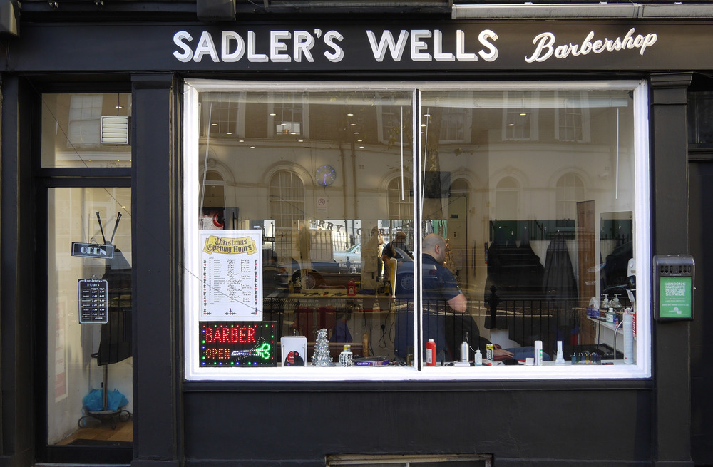 Signage for a barber shop opposite Sadler's Wells in Islington